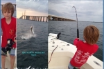 Devon catches his first tarpon just off the Sunshine Skyway