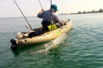 Kasper pulls a tarpon kayak-side during the 2014 Suncoast Tarpon Roundup