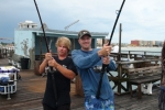 AJ Helenek and Kris Stein celebrate their double-hookup while fishing the landlubber division of the 2014 Suncoast Tarpon Roundup