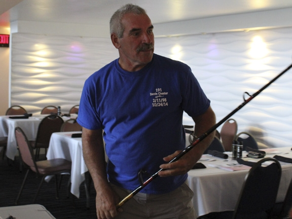 Greg L. checks out Janet Roshon's custom-built Harrington rod, up for auction at the 2015 STR Awards Banquet
