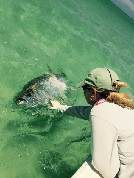 Mary Feinburg with a tarpon boatside during the 81 STR - Nice Catch!