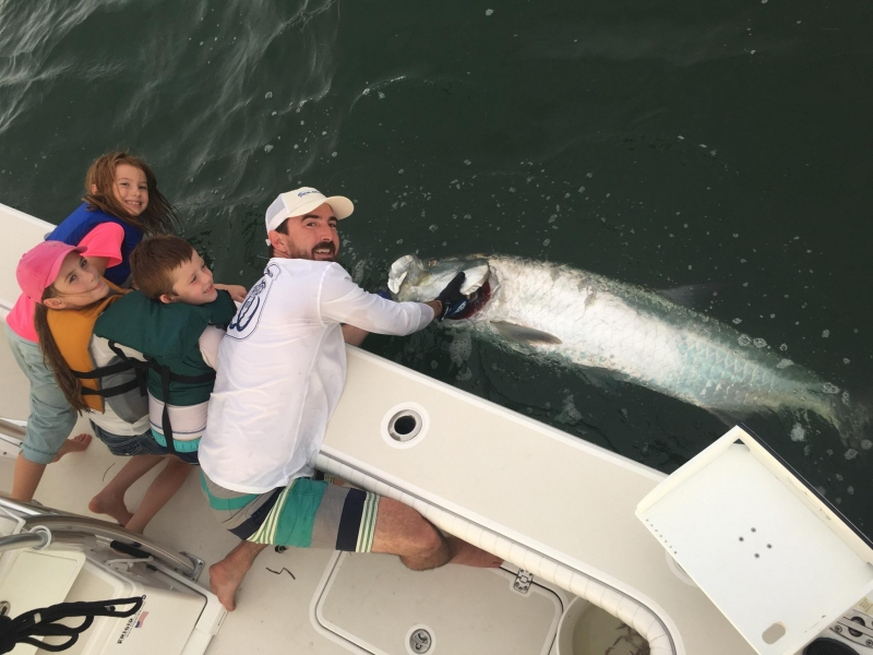 James Casper and crew with his Independence Day tarpon