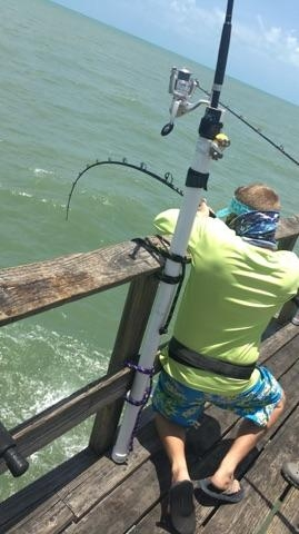 A.J. Helenek bows up on a tarpon from the pier